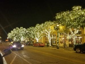 Bastrop downtown with trees that have holiday lights.